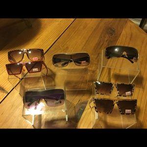 Lot of Snooki by Nicole Polizzi sunglasses.